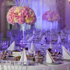 50877335 - table setting at a luxury wedding reception. beautiful flowers on the table.